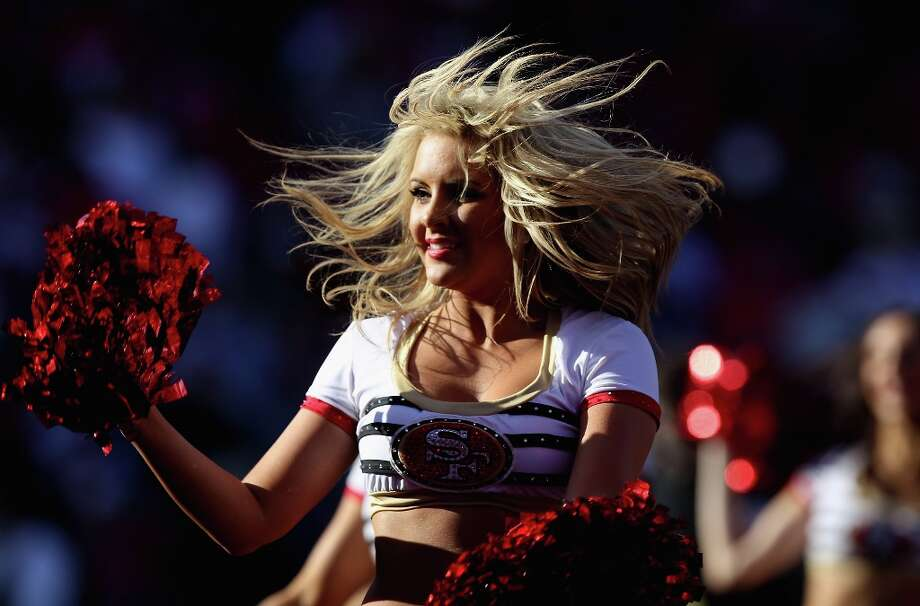 Now let's move on to the 49ers cheerleaders, who are known as the Gold Rush.Here, a cheerleader performs during the NFC Divisional playoff game between the San Francisco 49ers and the New Orleans Saints at Candlestick Park on January 14, 2012 in San Francisco, California. Photo: Jed Jacobsohn, Getty Images / 2012 Getty Images