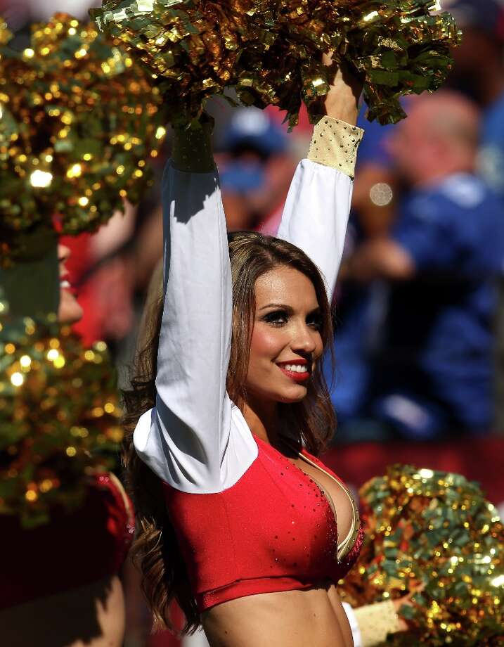 A 49ers cheerleader performs during the game between the New York Giants and the San Francisco 49ers at Candlestick Park on October 14, 2012 in San Francisco, California. Photo: Stephen Dunn, Getty Images / 2012 Getty Images