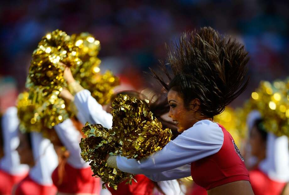 The San Francisco 49ers Gold Rush Cheerleaders perform during an NFL football game between the Miami Dolphins and San Francisco 49ers at Candlestick Park on December 9, 2012 in San Francisco, California. Photo: Thearon W. Henderson, Getty Images / 2012 Thearon W. Henderson