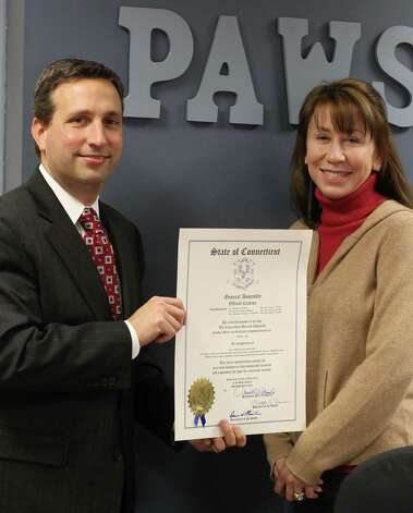 Last month, state Sen. Bob Duff (D-Norwalk) delivered an official citation to celebrate PAWS' 50th Anniversary to Ilona Bencze-Zimmer, PAWS Board of Directors. PAWS has been in existence since June 1962 and has helped find homes for more than 16,000 animals over the years. Photo: Contributed Photo