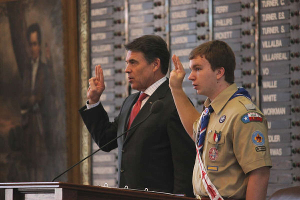 Gov. Rick Perry recites the Boy Scouts' oath at during the youth group's 64th annual Report to the State in Austin on Saturday, Feb. 2, 2013.
