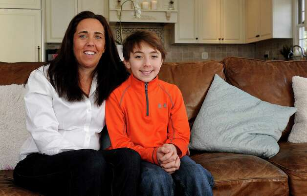 Jack Arnold and his mother, Anne, pose for a photo in their Fairfield home on Saturday, February 2, 2013. Arnold will be visiting the Stamford IHOP on Tuesday, February 5, during to help the restaurant's nationwide effort to raise money for children's hospitals. Photo: Lindsay Perry / Stamford Advocate