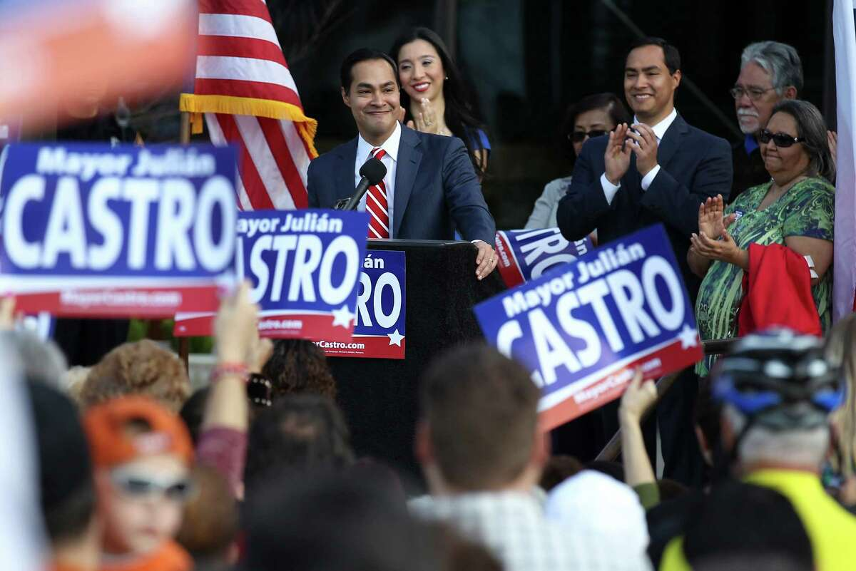 Julián Castro (at lectern), backed by members of his family, officially announces his intention to seek a third term as mayor of San Antonio.
