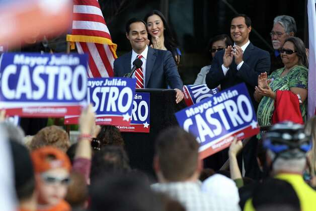 Julián Castro (at lectern), backed by members of his family, officially announces his intention to seek a third term as mayor of San Antonio. Photo: Kin Man Hui, San Antonio Express-News / © 2012 San Antonio Express-News