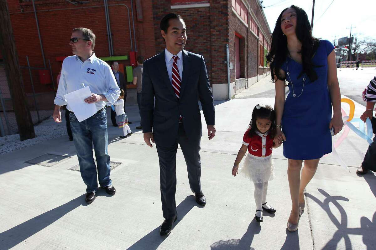 Mayor Julian Castro (center) along with his wife, Erica, and their daughter, Carina, arrive at a rally to announce his intention to seek a third term as city mayor on Saturday, Feb. 2, 2013. A crowd gathered in front of the Overland Partners Architects building on Jones Street to hear Castro talk about the city's prosperity and its future with him at the helm.