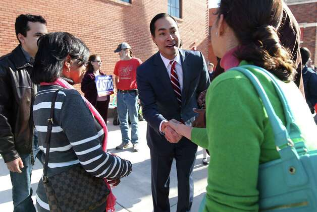 "Mayor Julián Castro shakes hands with supporters at a rally to announce his intention to seek a third term as city mayor on Saturday, Feb. 2, 2013. A crowd gathered in front of the Overland Partners Architects building on Jones Street to hear Castro talk about the city's prosperity and its future with him at the helm. ""For those of you who are wondering, I'm not going anywhere,"" a phrase that Castro has reiterated despite his newly-found notoriety around the nation as an upcoming politician. Photo: Kin Man Hui, San Antonio Express-News / © 2012 San Antonio Express-News"