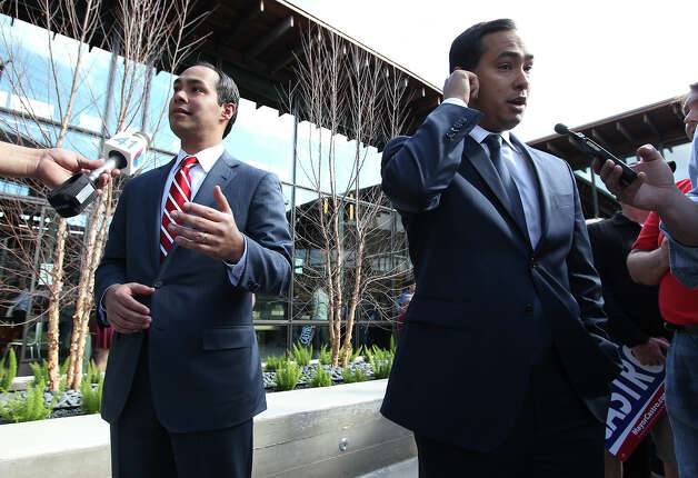 Mayor Castro (left) and his brother, U.S. Rep. Joaquín Castro, D-San Antonio, speak with reporters after the announcement. Photo: Kin Man Hui, San Antonio Express-News / © 2012 San Antonio Express-News