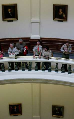 Boy Scouts are seen in the rotunda of the Texas State Capitol as they wait to hear Gov. Rick Perry speak during the annual Boy Scouts Parade and Report to State, Saturday, Feb. 2, 2013, in Austin, Texas. Perry says he hopes the Boy Scouts of America doesn't move soften its mandatory no-gays membership policy. Photo: Eric Gay