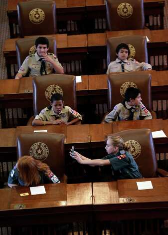 Scouts sit in the House Chambers at the Texas State Capitol as they wait to hear Gov. Rick Perry speak during the annual Boy Scouts Parade and Report to State, Saturday, Feb. 2, 2013, in Austin, Texas. Perry says he hopes the Boy Scouts of America doesn't move soften its mandatory no-gays membership policy. Photo: Eric Gay