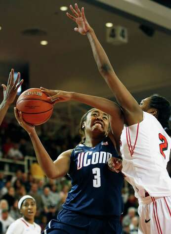 Connecticut forward Morgan Tuck (3) shoots a basket against St. John's forward Amber Thompson (2) during the first half of theiranNCAA college basketball game, Saturday, Feb. 2, 2013, at St. John's University in New York. (AP Photo/John Minchillo) Photo: John Minchillo, AP / Associated Press