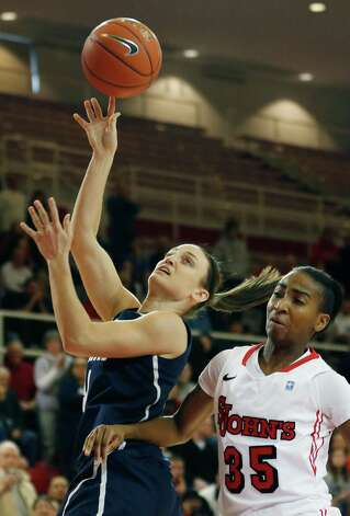 Connecticut guard Kelly Faris (34) shoots a basket against St. John's guard Shenneika Smith (35) during the first half of an NCAA college basketball game, Saturday, Feb. 2, 2013, at St. John's University in New York. (AP Photo/John Minchillo) Photo: John Minchillo, AP / Associated Press
