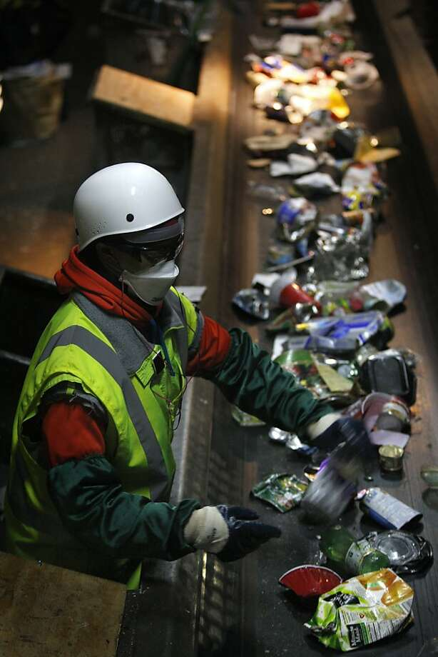 Workers sort recyclable materials at Recology's Pier 96 operation in San Francisco. Photo: Liz Hafalia, The Chronicle