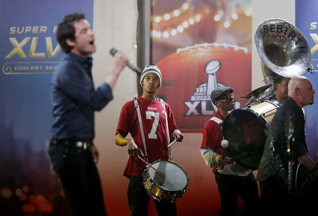 A background band with 49er fans in it helped lead singer Patrick Monahan with a tune. In what was one of the biggest concerts of the Super Bowl week, Train performed for hundreds of fans just across the street from the New Orleans Convention Center Friday February 1, 2013. Photo: Brant Ward, The Chronicle