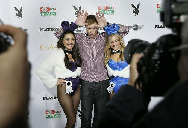 Former NFL player Jeremy Shocker poses with playmates Pilar and Nikki as he arrives at Jax Brewery who is hosting this year's Playboy Superbowl party on Friday Feb. 1, 2013 in New Orleans, La. Photo: Michael Macor, The Chronicle