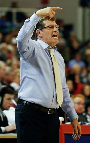 Connecticut head coach Geno Auriemma shouts to his players during the second half of a NCAA college basketball game against St. John's, Saturday, Feb. 2, 2013, at St. John's University in New York. Connecticut defeated St. John's 71-65.(AP Photo/John Minchillo) Photo: John Minchillo, Associated Press / FR170537 AP