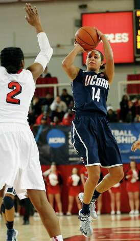 Connecticut guard Bria Hartley (14) shoots a basket over St. John's forward Amber Thompson (2) during the second half of their NCAA college basketball game, Saturday, Feb. 2, 2013, at St. John's University in New York. (AP Photo/John Minchillo) Photo: John Minchillo, Associated Press / FR170537 AP