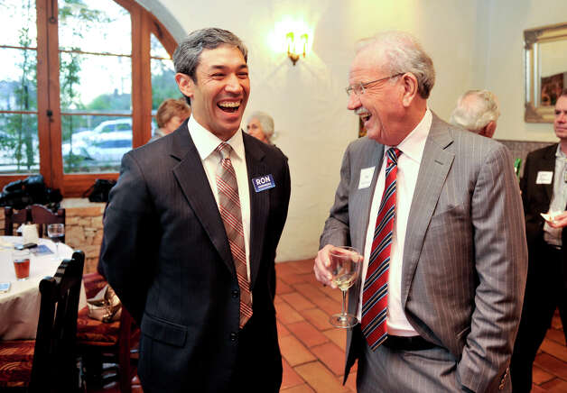 District 8 City Council candidate Ron Nirenberg shares a laugh with former Mayor Phil Hardberger. Nirenberg is campaigning against Rolando Briones, who owns an engineering firm and is the frontrunner. Photo: Robin Jerstad, For The Express-News