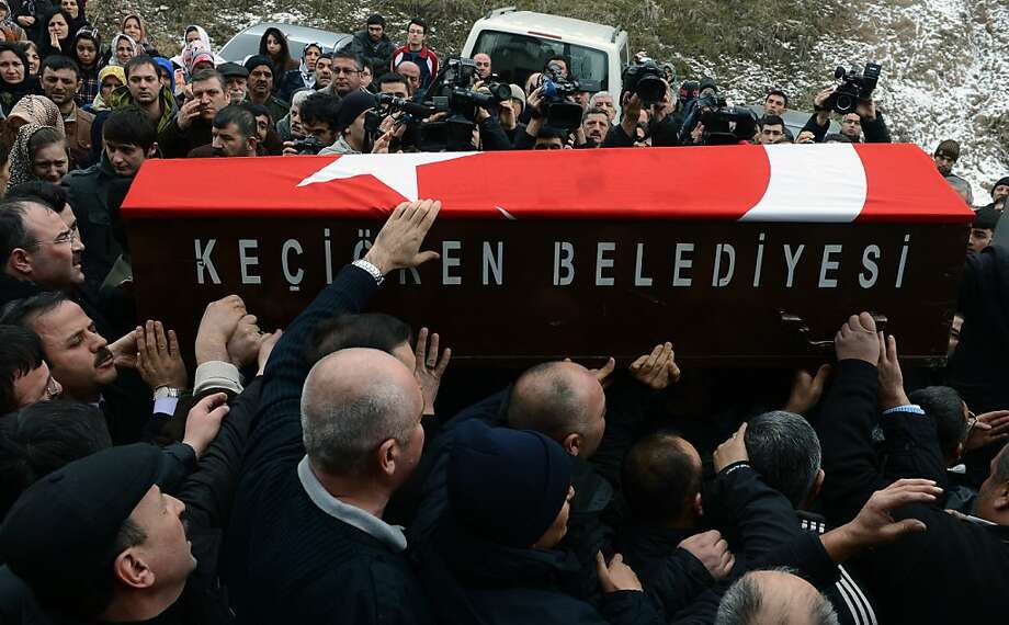 People carry a Turkish flag-covered  coffin of Mustafa Akarsu, an embassy security guard killed when a suicide bomber struck the American Embassy in Turkish capital on Friday, during his funeral in Ankara, Turkey, Saturday, Feb. 2, 2013. The White House described the killing as a terrorist attack and Washington immediately warned Americans to stay away from all U.S. diplomatic facilities in Turkey and to be wary in large crowds. Photo: Associated Press
