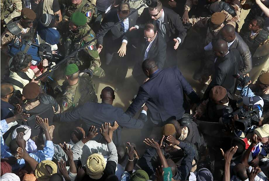 French President Francois Hollande, upper center,  is surrounded by security as he greets well-wishers during his two-hour-long visit to Timbuktu, Mali, Saturday Feb. 2, 2013.(AP Photo/Jerome Delay) Photo: Jerome Delay, Associated Press