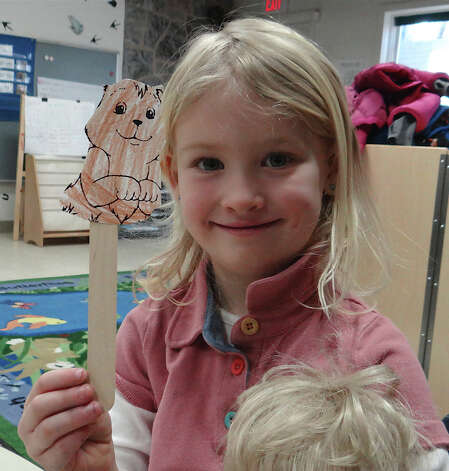 Molly Prior, 5, holds up a groundhog cutout mounted on a popsicle stick, a craft activity Saturday during the Groundhog Day programs at Earthplace.  WESTPORT NEWS, CT 2/2/13 Photo: Mike Lauterborn / Westport News contributed