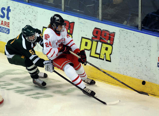 Fairfield Prep's #24 Brendan Killoy heads off Hamden's Eric Perez while chasing the puck, during boys hockey action at the Webster Bank Arena in Bridgeport, Conn. on Saturday February 2, 2013. Photo: Christian Abraham / Connecticut Post