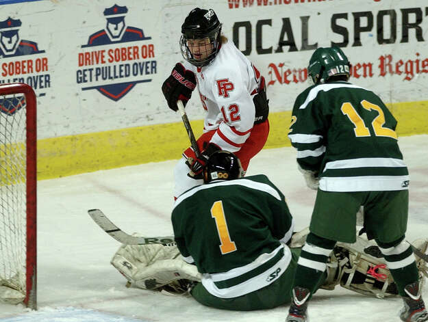 Fairfield Prep's Jack Quinn goes up against Hamden goalie Matt Hoff, during boys hockey action at the Webster Bank Arena in Bridgeport, Conn. on Saturday February 2, 2013. Photo: Christian Abraham / Connecticut Post
