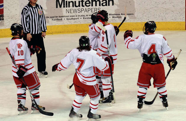 Fairfield Prep teammates rush in to celebrate a goal by #9 Nick Bargiello, during boys hockey action against Hamden at the Webster Bank Arena in Bridgeport, Conn. on Saturday February 2, 2013. Photo: Christian Abraham / Connecticut Post