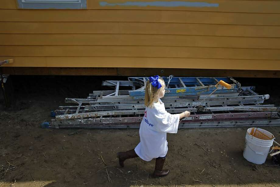 Hailey Helm, 5, helps paint a house with the Benjamin Moore group in the Ninth Ward of New Orleans, La., on Saturday, February 2, 2013, as part of a Make It Right volunteer day. Photo: Carlos Avila Gonzalez, The Chronicle