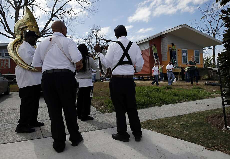 The Kin Folk Brass Band plays for Benjamin Moore volunteers as they paint a house in the Ninth Ward of New Orleans, La., on Saturday, February 2, 2013, as part of the Make It Right volunteer day. Photo: Carlos Avila Gonzalez, The Chronicle
