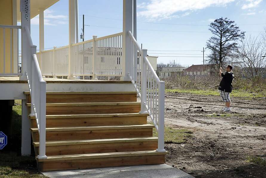 Garrett Dorfman photographs his new house in the Ninth Ward of New Orleans, La., on Saturday, Februa