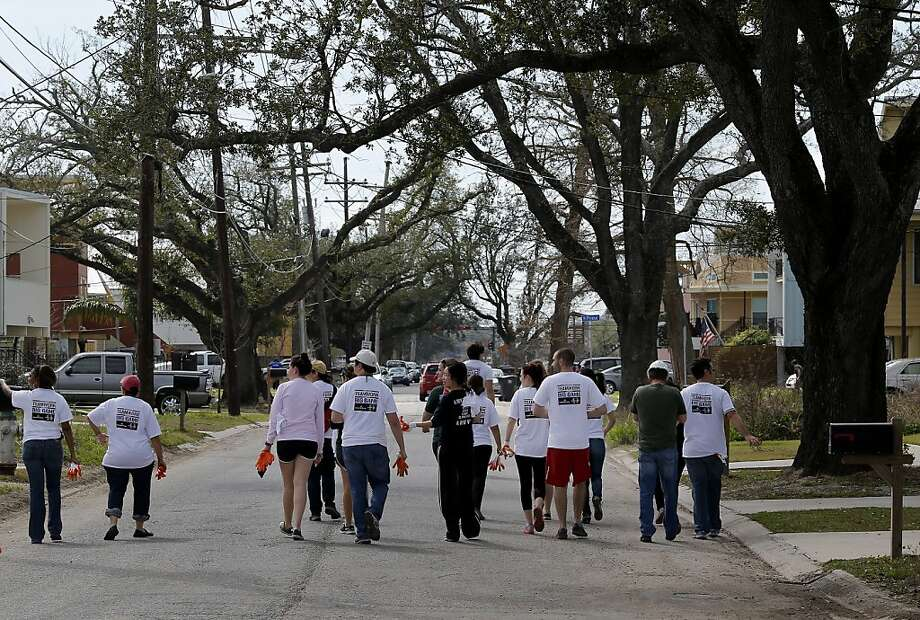 Volunteers from Tulane University in New Orleans walked down Tennessee Street in the Ninth Ward. In August of 2005, Hurricane Katrina wiped out most of the homes in the Ninth Ward of New Orleans, La. Now nearly eight years later, the community is rebuilding thanks, in part, to volunteers who were out in force the day before the Super Bowl Saturday February 2, 2013. Photo: Brant Ward, The Chronicle