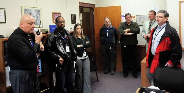 Gary Bocaccio, Danbury High School principal, left, reviews procedures with safety advocates and administrators after a lockdown drill Friday, Feb. 1, 2013. Photo: Michael Duffy / The News-Times