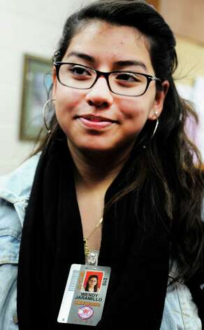 Wendy Jaramillo, a Danbury High School sophmore, wears one of the new student ID's before a lockdown drill Friday, Feb. 1, 2013. Photo: Michael Duffy / The News-Times