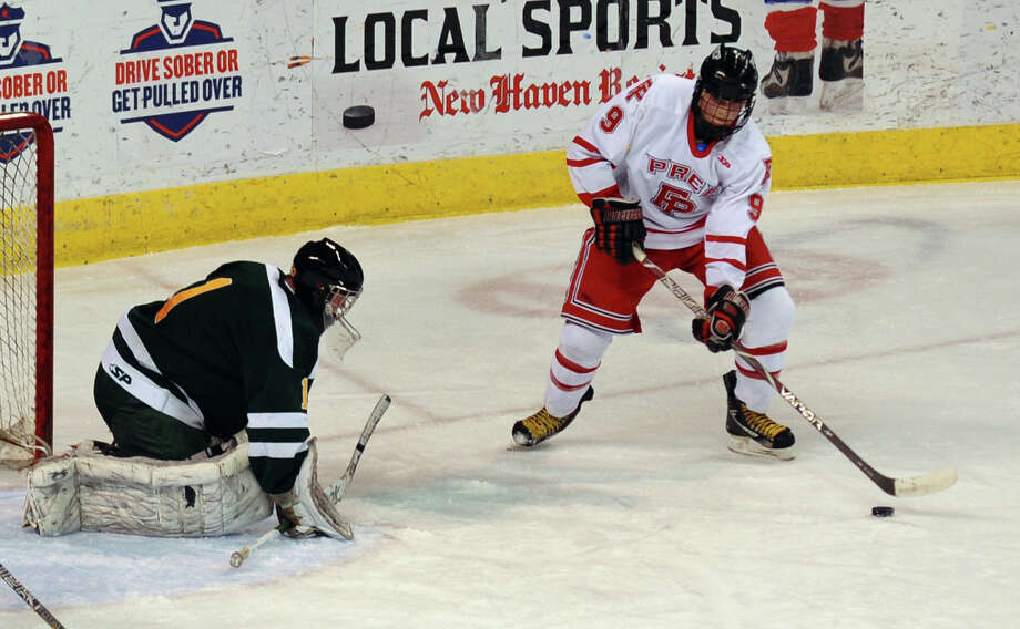 Fairfield Prep's Nick Bargiello prepares to send the puck past Hamden goalie Matt Hoff to score, during boys hockey action at the Webster Bank Arena in Bridgeport, Conn. on Saturday February 2, 2013. Photo: Christian Abraham / Connecticut Post