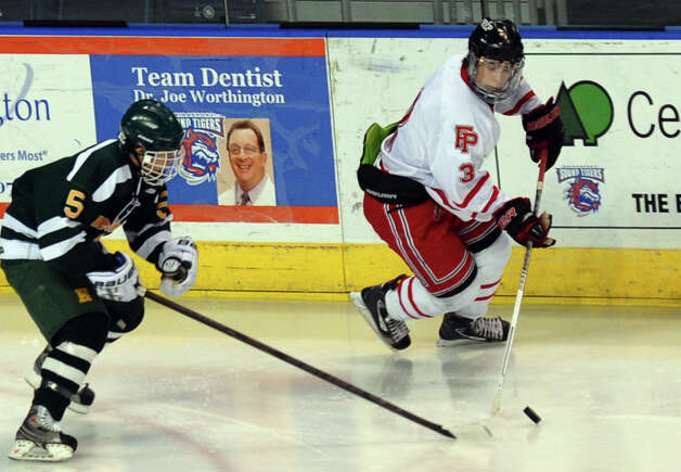 Fairfield Prep's Matt Wikman intercepts the puck before Hamden Eric Perez, during boys hockey action at the Webster Bank Arena in Bridgeport, Conn. on Saturday February 2, 2013. Photo: Christian Abraham / Connecticut Post