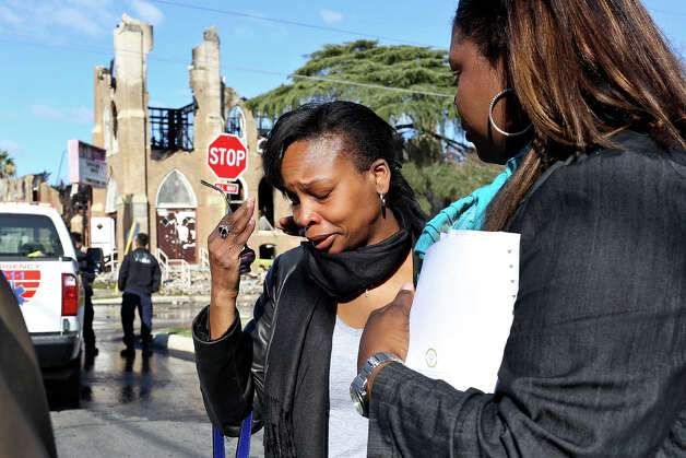 City Councilwoman Ivy Taylor (center) is overcome with emotion as she's greeted at the scene by church member Tiffanie Wilson. For today, at least, the congregation will worship downtown at the Convention Center. Photo: Lisa Krantz, San Antonio Express-News / © 2012 San Antonio Express-News