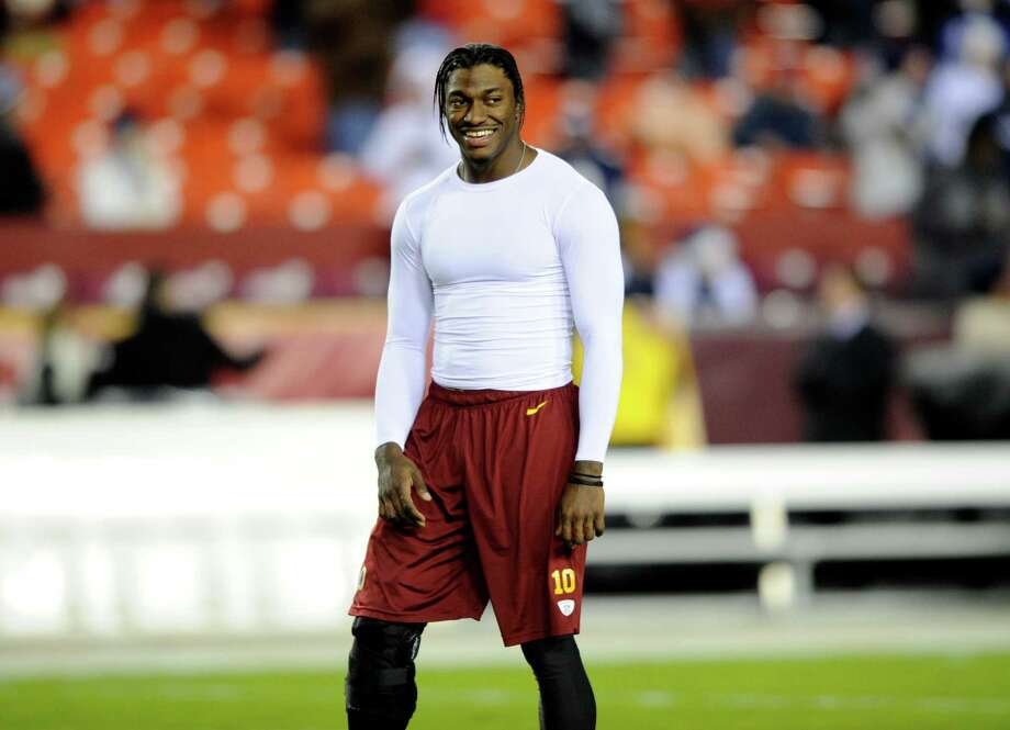 Washington Redskins quarterback Robert Griffin III (10) laughs before an NFL football game against the Dallas Cowboys, Sunday, Dec. 30, 2012, in Landover, Md. (AP Photo/Nick Wass) Photo: Nick Wass, Associated Press / FR67404 AP