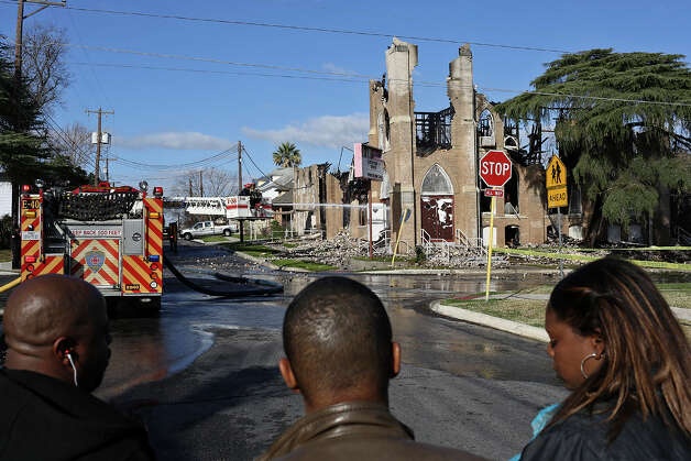 Parishioners Tiffanie Wilson, right, and Audie Walter, left, with Skip Wilson, look at the damage to their church, Childress Memorial Church Of God In Christ, after a multi-alarm fire destroyed it overnight in San Antonio on Saturday, Feb. 2, 2013. Wilson attends a different church but has family who attend Childress Memorial. Photo: Lisa Krantz, San Antonio Express-News / © 2012 San Antonio Express-News