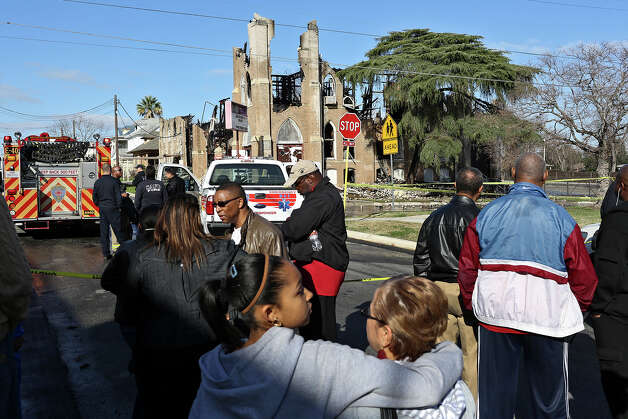 Parishioners including Deborah Jordan and her daughter, Alexis Bishop, 12, center, look at the damage after a multi-alarm fire overnight at Childress Memorial Church Of God In Christ in San Antonio on Saturday, Feb. 2, 2013. Photo: Lisa Krantz, San Antonio Express-News / © 2012 San Antonio Express-News