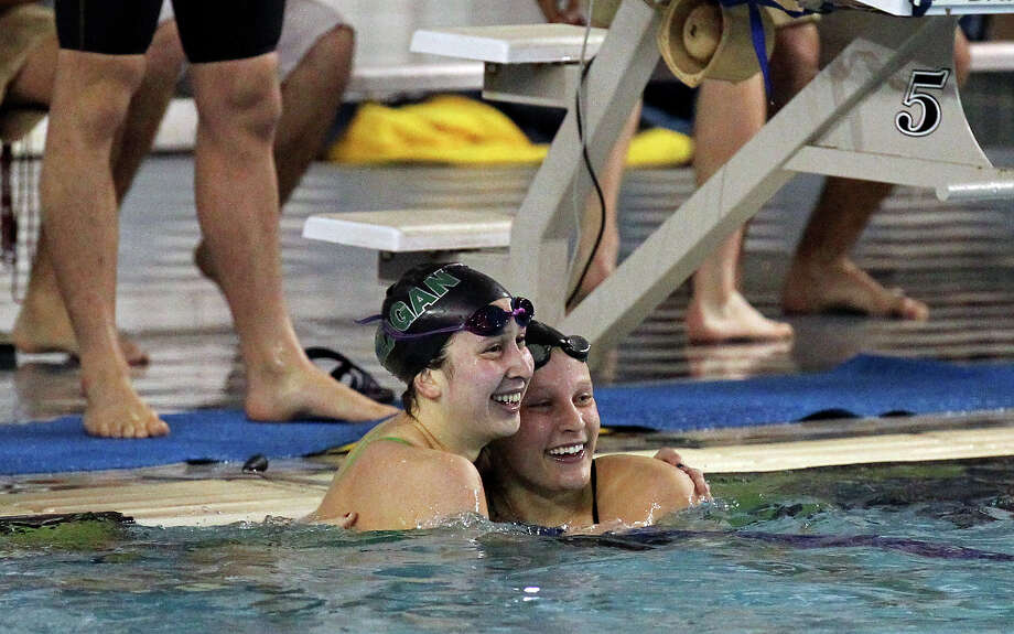 Reagan's Vanessa Duran (left) and teammate Mary Margaret Soderberg hug after they took first and second place respectively in the 200-yard IM at the District 26-5A swim meet at Josh Davis Natatorium on Saturday, Feb. 2, 2013. Duran finished first with a time of 2:07.63. Photo: Kin Man Hui, San Antonio Express-News / © 2012 San Antonio Express-News