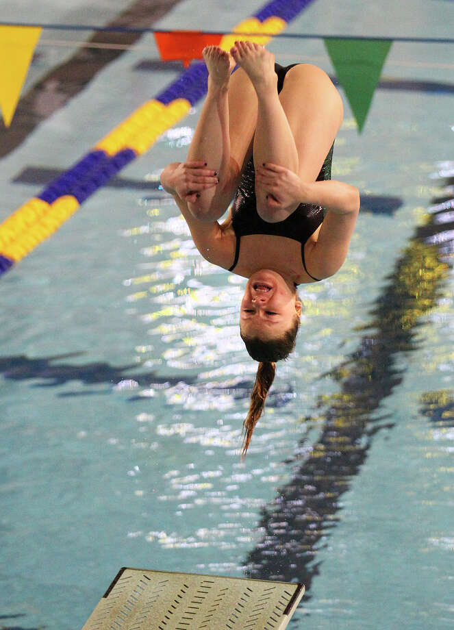 Reagan's Madison Lamey completes a dive during the 1-Meter Diving competition at the District 26-5A meet at Josh Davis Natatorium on Saturday, Feb. 2, 2013. Photo: Kin Man Hui, San Antonio Express-News / © 2012 San Antonio Express-News