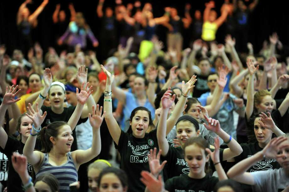 Participants dance during a Zumbathon fundraiser in honor of Deanna Rivers and Chris Stewart on Saturday, Feb. 2, 2013, at Orenda Elementary School in Clifton Park, N.Y. Proceeds from ticket sales, raffles , baked goods and vendor sales will benefit the scholarship funds of these Shenendehowa athletes who died in a car crash. (Cindy Schultz / Times Union) Photo: Cindy Schultz / 10021020A
