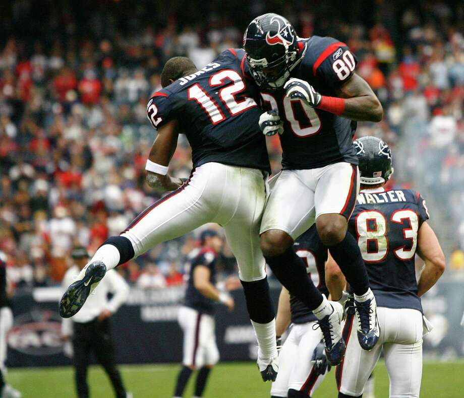 Jacoby Jones, left, is shown celebrating a score with receiver Andre Johnson, who served as a mentor to him. Photo: Nick De La Torre, Houston Chronicle / Houston Chronicle