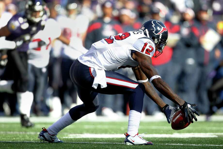 Jan. 15, 2012Jacoby Jones drops the ball on a punt return during the first quarter of  an AFC divisional playoff football game against the Ravens. Photo: Karen Warren, Houston Chronicle / © 2012  Houston Chronicle