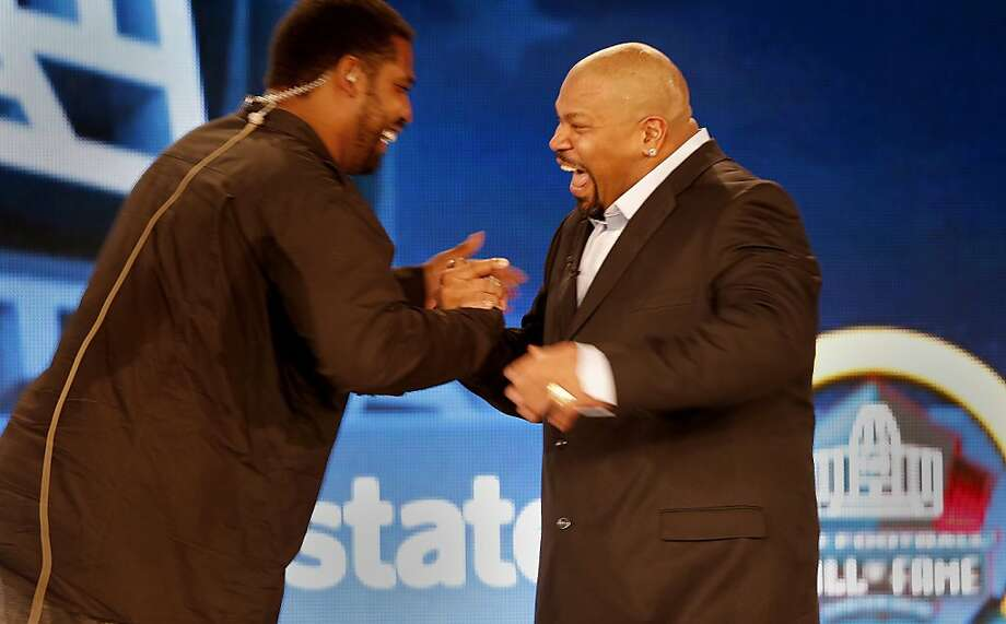 Larry Allen (right), a 49er at career's end, greets fellow 2013 Hall of Fame inductee Jonathan Ogden. Photo: Brant Ward, The Chronicle