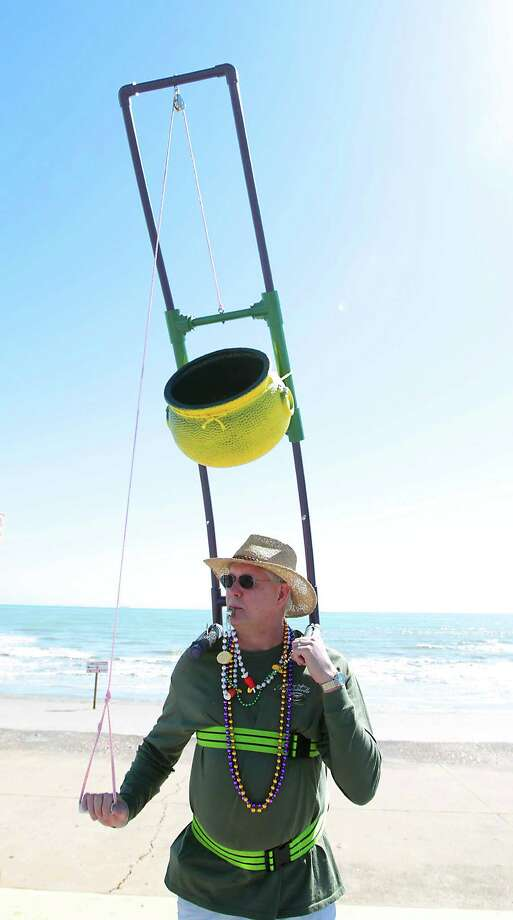 Steve Stone whistles for beads during the Mystic Krewe of Aquarius 25th annual Mardi Gras Kick off Parade along Seawall Blvd. Saturday, Feb. 2, 2013, in Galveston. Photo: James Nielsen, Chronicle / © Houston Chronicle 2013
