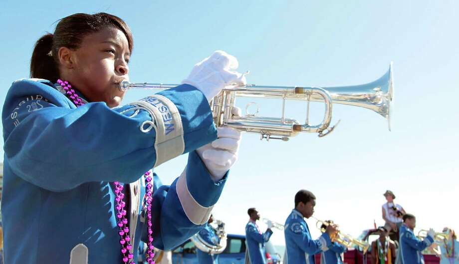 A member of Westbury High School marching band performs during the Mystic Krewe of Aquarius 25th annual Mardi Gras Kick off Parade along Seawall Blvd. Saturday, Feb. 2, 2013, in Galveston. Photo: James Nielsen, Chronicle / © Houston Chronicle 2013