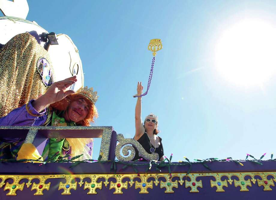 People aboard a float toss beads during the Mystic Krewe of Aquarius 25th annual Mardi Gras Kick off Parade along Seawall Blvd. Saturday, Feb. 2, 2013, in Galveston. Photo: James Nielsen, Chronicle / © Houston Chronicle 2013
