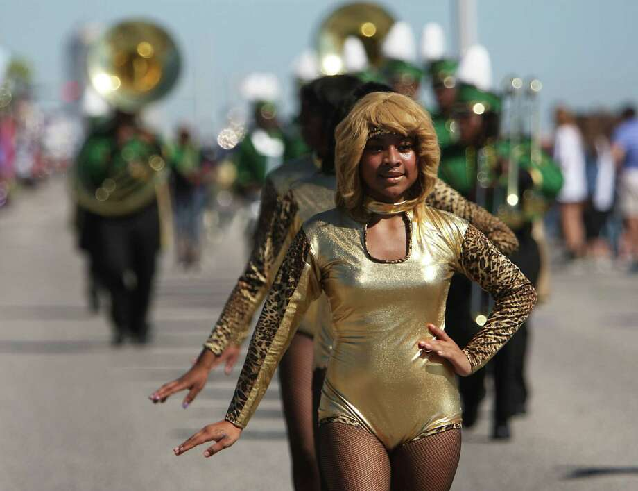 Worthing High School marching band performs during the Mystic Krewe of Aquarius 25th annual Mardi Gras Kick off Parade along Seawall Blvd. Saturday, Feb. 2, 2013, in Galveston. Photo: James Nielsen, Chronicle / © Houston Chronicle 2013