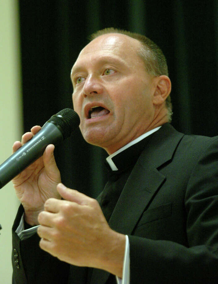 Monsignor Kevin Wallin addresses the faithful at a packed house at the Catholic Center on Jewett Avenue in Bridgeport, May 4, 2006. Photo: File Photo/Paul Desmarais, File Photo / Connecticut Post File Photo